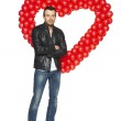 Man standing in front of heart shape — Stock Photo #40011967