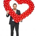 Businessman holding heart shape — Stock Photo
