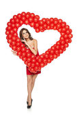 Love woman holding red heart shaped balloons — Stock Photo