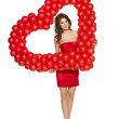 Love woman holding red heart shaped balloons — Stock Photo #40370725