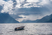 Fishing boat floating on water on fjord — Stock Photo