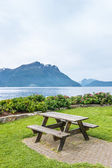 Table and benches for picnic on fjord shore — Stock Photo