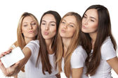 Girls making self portrait with a smartphone — Stock Photo