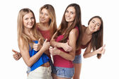 Happy group of friends gesturing thumbs up — Stock Photo