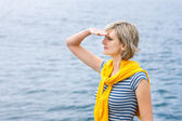 Middle age woman outdoors  looking in distance — Stock Photo