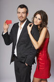 Fashion couple with blank credit card — Stock Photo