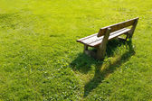Lonely bench in backyard. — Stock Photo