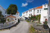 White wooden houses in old town of Skudeneshavn — Stock Photo