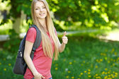 Smiling woman student with backpack — Stock Photo