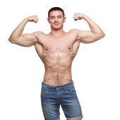 Muscle man posing in studio — Stock Photo