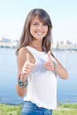 Gorgeous young woman showing thumbs up — Stock Photo