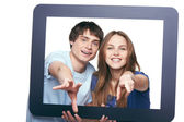 Happy couple looking through tablet frame — Stock Photo
