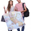 Couple of tourists holding map — Stock Photo #50811889