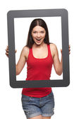 Excited teen girl looking through frame, — Stockfoto
