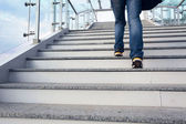 Man on office stairs — Stock Photo