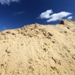 Sand dune and blue sky — Stock Photo