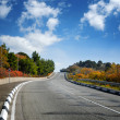 Wide road between autumn trees — Stock Photo