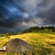 Touristic tent and storm clouds — Stock Photo