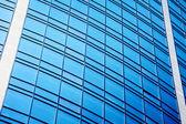 Contemporary skyscraper with glass windows — Stock Photo