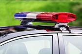 Politie-auto met sirene licht close-up — Stockfoto
