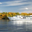 Large yacht swims by the river — Stock Photo #43612647