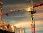 Construction site with crane and sunset — Stock Photo