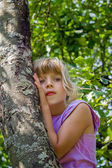 Little girl climbed into a tree — Stock Photo