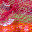 Royalty-Free Stock Photo: Red plastic mesh with tangerines