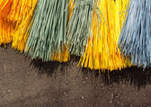 Multi-colored brooms — Stock Photo