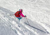 Little girl skier in the deep snow — Foto Stock