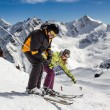 Adult  happy couple in winter mountains — Stock Photo