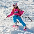 Stock Photo: Child skiing in sharp cornering