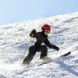 Stock Photo: Young skier on uneven slope