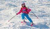Child skiing in sharp cornering — Stock Photo