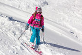 Little girl skier in the deep snow — Stock Photo