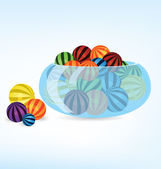 Colorful balls in bowl — Stock Vector
