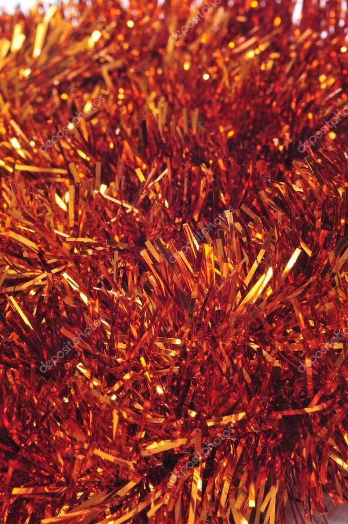 Closeup of a shiny golden tinsel garland — Photo #12456358
