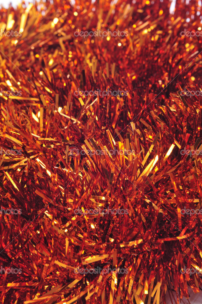 Closeup of a shiny golden tinsel garland  Foto Stock #12456358
