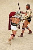 Gladiators on the arena of Roman Amphitheater of Tarragona, Spai — Stock Photo