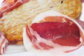 Spanish tortilla de patatas and serrano ham — Stock Photo