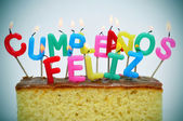 Cumpleanos feliz, happy birthday written in spanish — Stock Photo