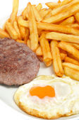 Combo platter with fried egg, burger and french fries — Foto Stock