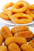 Spanish croquettes and calamares a la romana, breaded and fried — Stock Photo