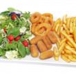 Spanish combo platter with salad, croquettes, calamares and fren - Stock Photo