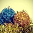 Christmas ball and golden tinsel with a retro effect — 图库照片