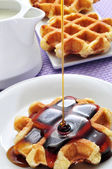 Waffle with syrup — Stock Photo