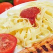 Tagliatelle and chicken - Stock Photo