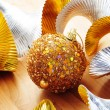 Royalty-Free Stock Photo: Golden christmas ball and golden and silver garland