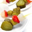 Spanish banderillas, skewers with pickles — Stock Photo #15945419
