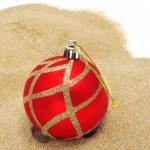 Christmas ball on the sand — Photo #16413553